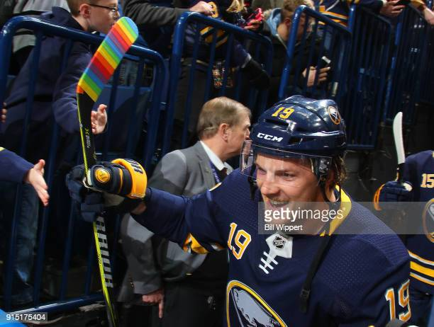 Jake McCabe of the Buffalo Sabres uses rainbowcolored hockey stick tape during Hockey Is For Everyone month before an NHL game against the Anaheim...