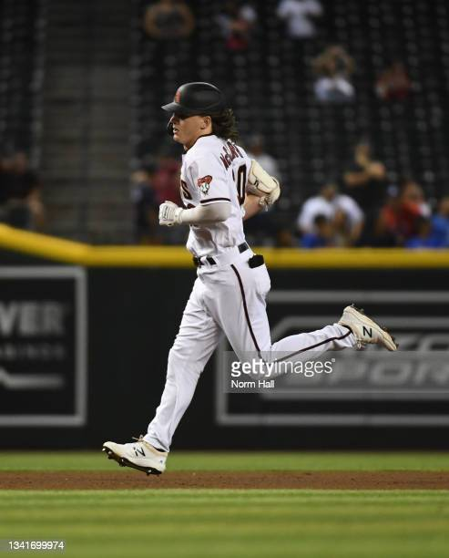 Jake McCarthy of the Arizona Diamondbacks rounds the bases after hitting a solo home run off of Richard Rodriguez of the Atlanta Braves during the...