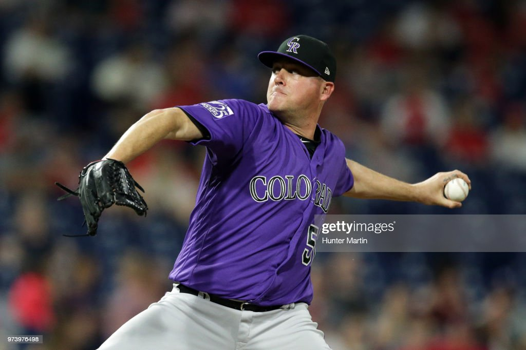 Jake McGee #51 of the Colorado Rockies delivers a pitch in the eighth inning during a game against the Philadelphia Phillies at Citizens Bank Park on June 13, 2018 in Philadelphia, Pennsylvania. The Rockies won 7-2.