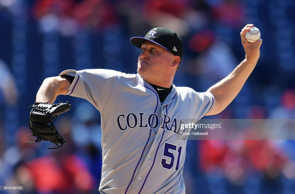 Jake McGee #51 of the Colorado Rockies delivers a pitch in the seventh inning against the Philadelphia Phillies at Citizens Bank Park on June 14, 2018 in Philadelphia, Pennsylvania.