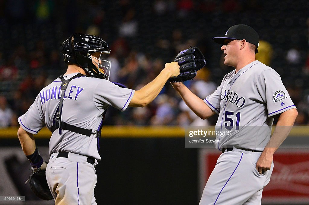 Jake McGee #51 of the Colorado Rockies is congrateulated by Nick Hundley #4 after closing out the game against the Arizona Diamondbacks at Chase Field on April 30, 2016 in Phoenix, Arizona. The Colorado Rockies won 5-2.