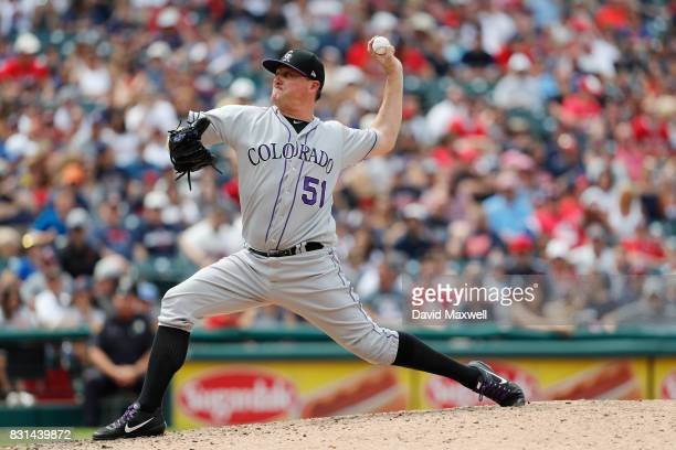 Jake McGee of the Colorado Rockies pitches against the Cleveland Indians in the eighth inning at Progressive Field on August 9 2017 in Cleveland Ohio...