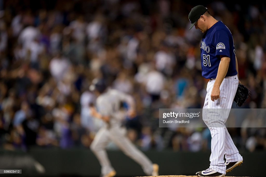 Jake McGee #51 of the Colorado Rockies reacts after giving up a ninth inning 3-run go ahead homerun to Wil Myers #4 of the San Diego Padres during a game at Coors Field on June 10, 2016 in Denver, Colorado.