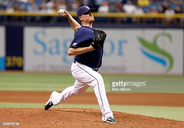 Jake McGee of the Tampa Bay Rays pitches during the ninth inning of a game against the Detroit Tigers on August 21 2014 at Tropicana Field in St...