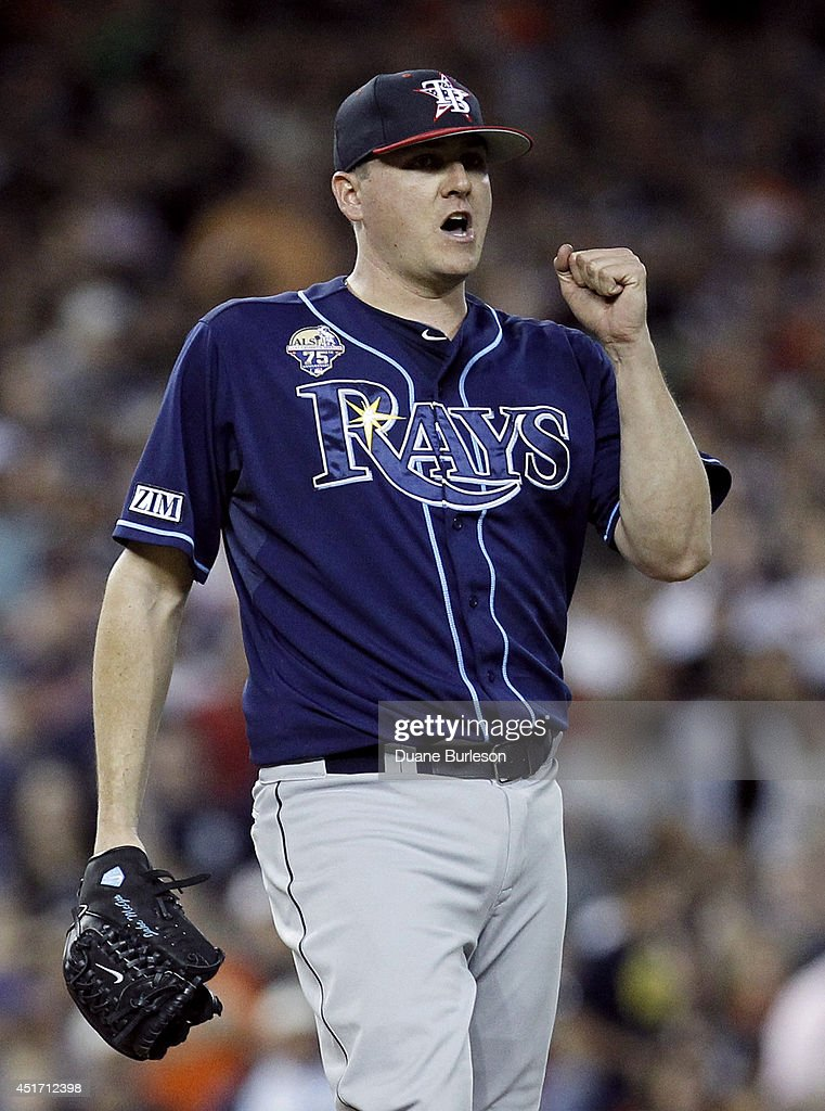 Jake McGee #57 of the Tampa Bay Rays pumps his fist after recording his fourth save in the Rays 6-3 win over the Detroit Tigers at Comerica Park on July 4, 2014 in Detroit, Michigan.