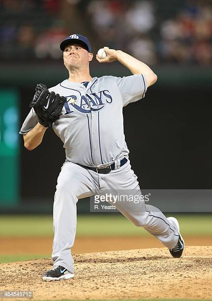 Jake McGee of the Tampa Bay Rays throws in the tenth inning against the Texas Rangers at Globe Life Park in Arlington on August 12 2014 in Arlington...