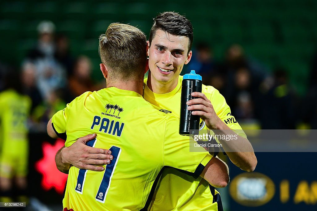 Jake McGing and Connor Pain of the Central Coast Mariners embrace after the draw during the round one A-League match between the Perth Glory and the Central Coast Mariners at nib Stadium on October 8, 2016 in Perth, Australia.