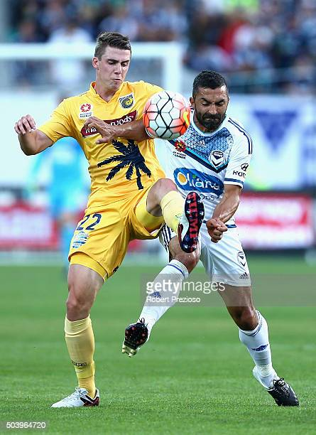 Jake Mcging of Central Coast and Fahid Ben Khalfallah of Melbourne contest the ball during the round 14 ALeague match between the Central Coast...