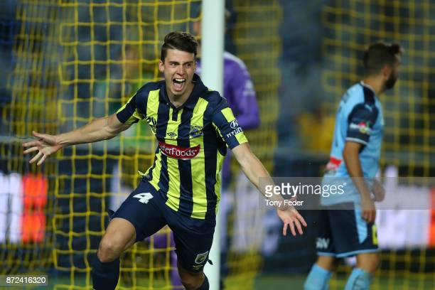 Jake McGing of the Mariners celebrates scoring a goal during the round six ALeague match between the Central Coast Mariners and Sydney FC at Central...