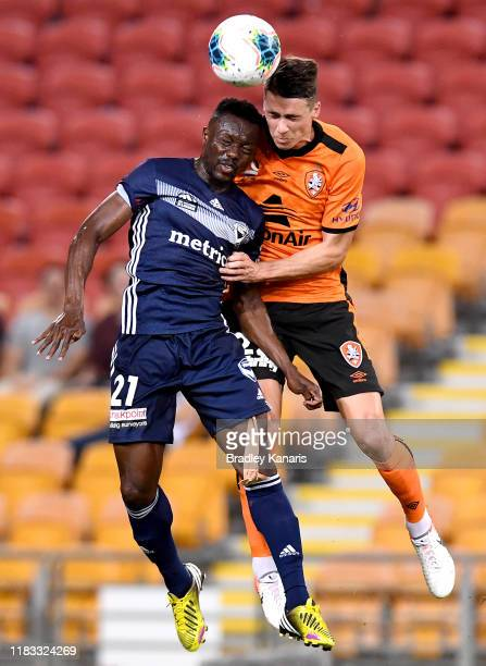 Jake McGing of the Roar and Adama Traore of the Victory challenge for the ball during the round three ALeague match between the Brisbane Roar and the...