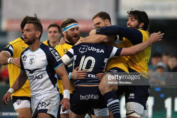 Jake McIntyre of Agen celebrates with his teammates after scoring a try during the French Top 14 match between SA Agen and Montpellier on March 3...