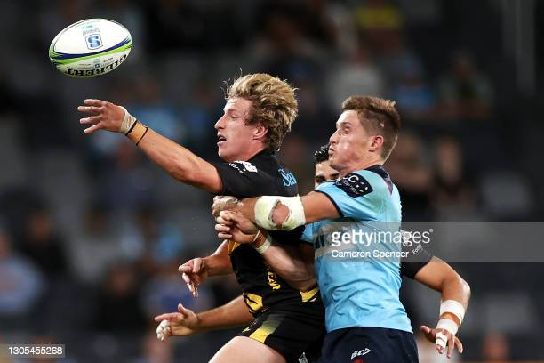 Jake McIntyre of the Force offloads the ball during the round three Super RugbyAU match between the Waratahs and the Western Force at Bankwest...