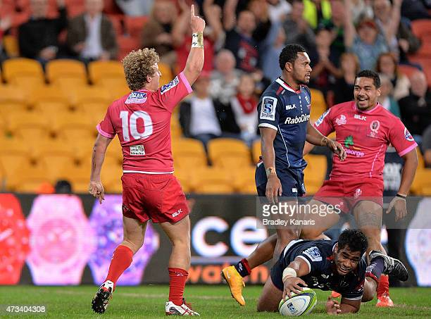 Jake McIntyre of the Reds celebrates scoring a try during the round 14 Super Rugby match between the Queensland Reds and the Melbourne Rebels at...