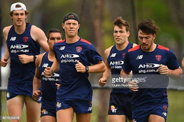 Jake Melksham and Michael Hibberd of the Demons run laps with their new team mates during a Melbourne Demons AFL preseason training session at...
