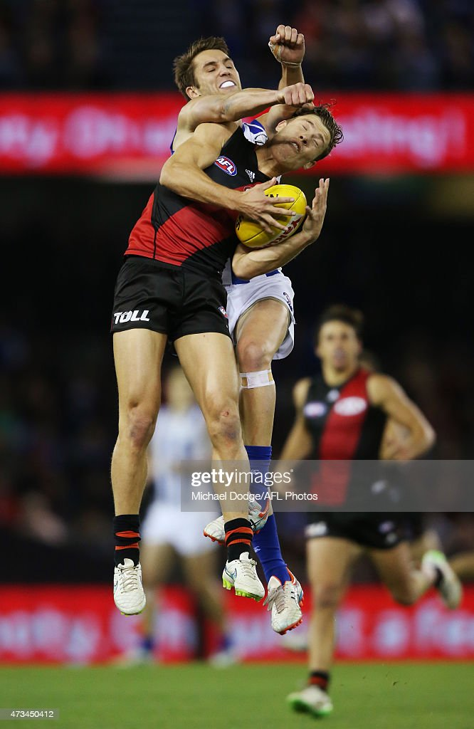 Jake Melksham of the Bombers marks the ball against Jamie Macmillan of the Kangaroos during the round seven AFL match between the Essendon Bombers and the North Melbourne Kangaroos at Etihad Stadium on May 15, 2015 in Melbourne, Australia.