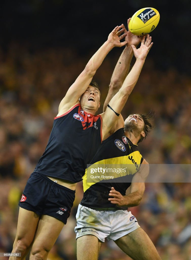 Jake Melksham of the Demons and Alex Rance of the Tigers during the round five AFL match between the Melbourne Demons and the Richmond Tigers at the Melbourne Cricket Ground on April 24, 2018 in Melbourne, Australia.