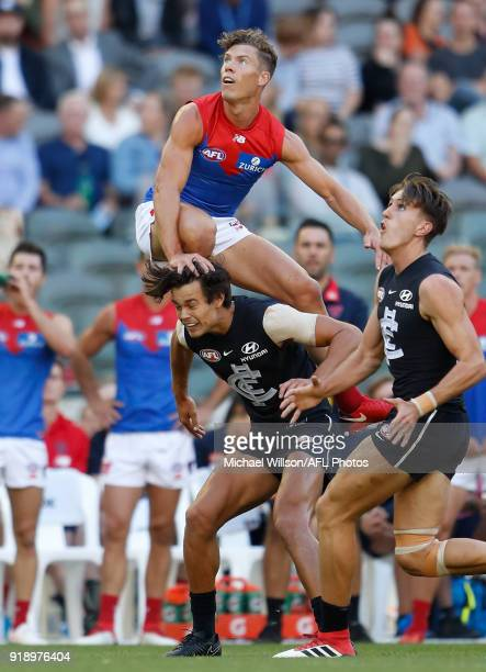 Jake Melksham of the Demons attempts a spectacular mark over Jack Silvagni of the Blues during the AFLX match between the Melbourne Demons and the...
