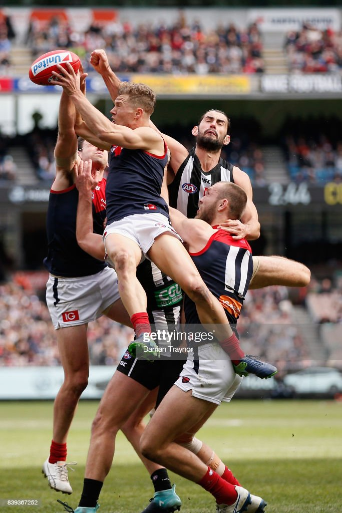 Jake Melksham of the Demons flies for the ball during the round 23 AFL match between the Collingwood Magpies and the Melbourne Demons at Melbourne Cricket Ground on August 26, 2017 in Melbourne, Australia.