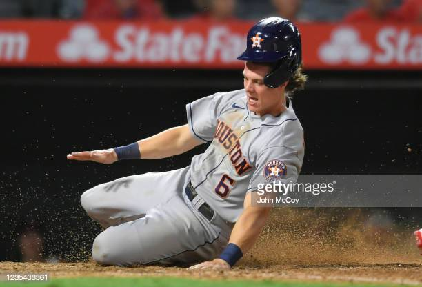 Jake Meyers of the Houston Astros is safe at home in the 12th inning against the Los Angeles Angels at Angel Stadium of Anaheim on September 22, 2021...