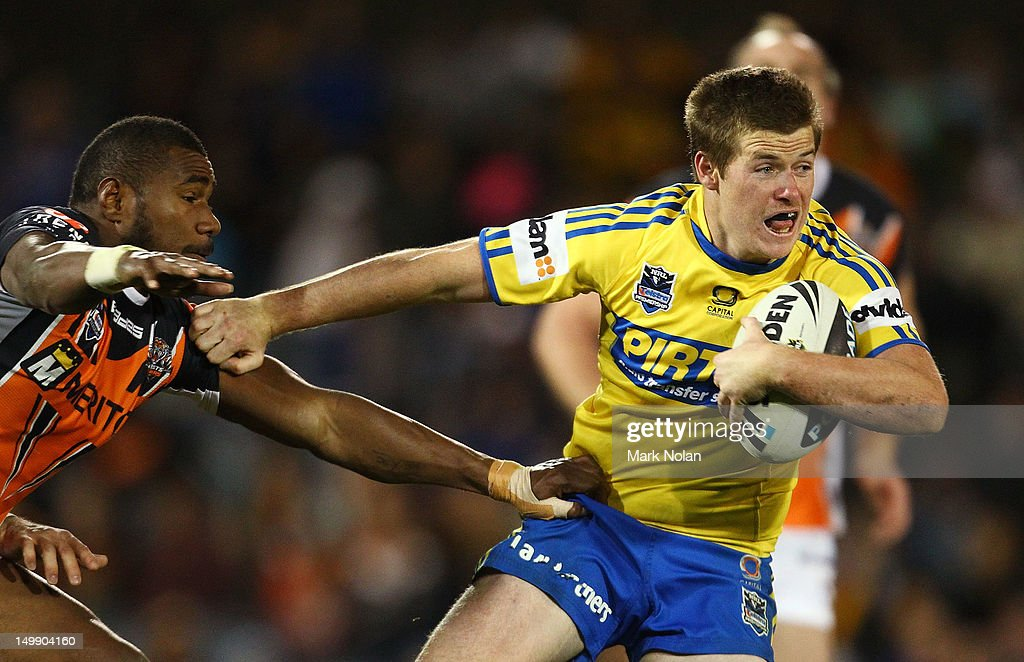 Jake Mullaney of the Eels mkaes a line break during the round 22 NRL match between the Wests Tigers and the Parramatta Eels at Campbelltown Sports Stadium on August 6, 2012 in Sydney, Australia.