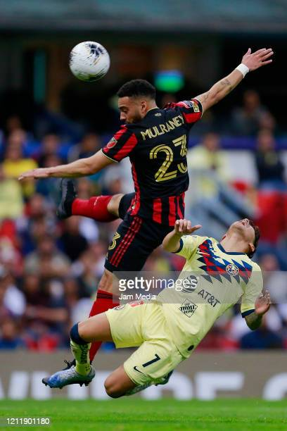 Jake Mulraney of Atlanta United fights for the ball with Leonardo Suarez of America during a quarter final first leg match between Club America and...