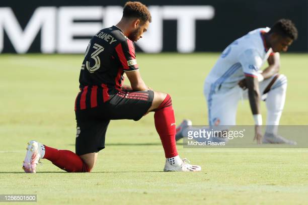 Jake Mulraney of Atlanta United takes a knee in support of the Black Lives Matter movement prior to the start of a Group E match against FC...