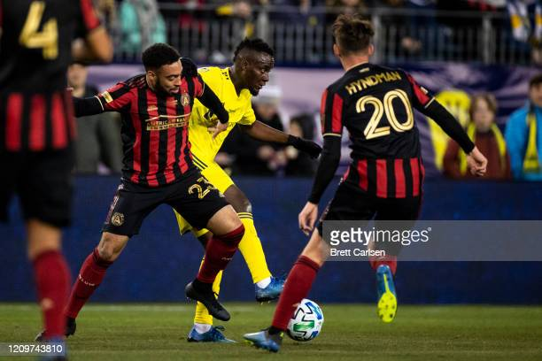 Jake Mulraney of the Atlanta United fouls David Accam of the Nashville SC as they battle for a loose ball during the first half at Nissan Stadium on...