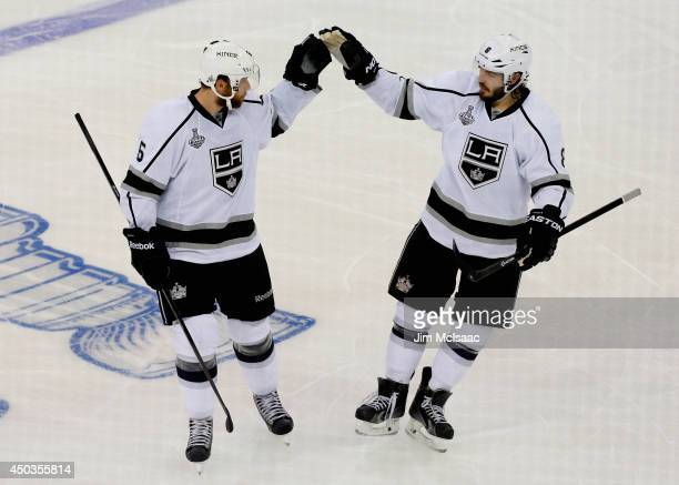 Jake Muzzin and Drew Doughty of the Los Angeles Kings celebrate Muzzin's goal on Henrik Lundqvist of the New York Rangers during the first period of...