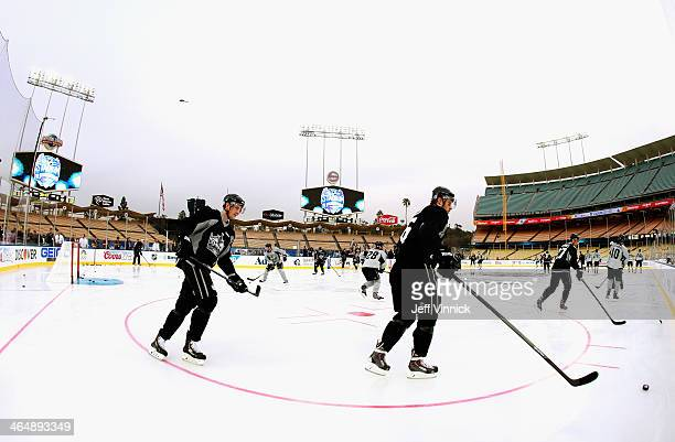 Jake Muzzin and Jeff Schultz of the Los Angeles Kings attend practice in preparation for the 2014 Coors Light NHL Stadium Series against the Anaheim...