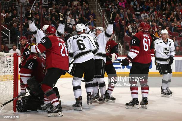 Jake Muzzin and Tanner Pearson of the Los Angeles Kings celebrate after Muzzin scored a power play goal past goaltender Mike Smith of the Arizona...