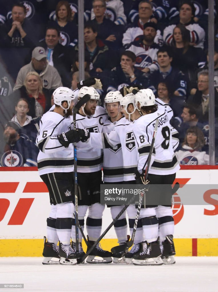 Jake Muzzin #6, Anze Kopitar #11, Tyler Toffoli #73, Dustin Brown #23 and Drew Doughty #8 of the Los Angeles Kings celebrate a third period goal against the Winnipeg Jets at the Bell MTS Place on February 20, 2018 in Winnipeg, Manitoba, Canada.