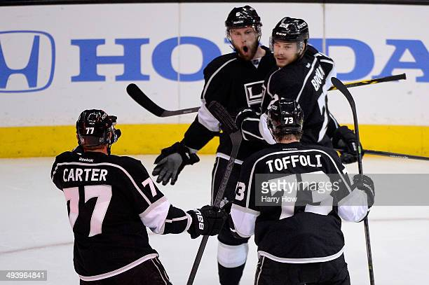 Jake Muzzin of the Los Angeles Kings and Dustin Brown celebrate Muzzin's first period goal against the Chicago Blackhawks in Game Four of the Western...
