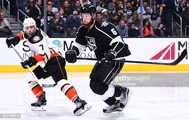 Jake Muzzin of the Los Angeles Kings battles for position against Andrew Cogliano of the Anaheim Ducks on November 1 2016 at Staples Center in Los...