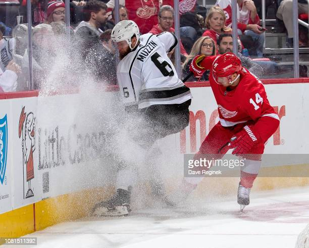 Jake Muzzin of the Los Angeles Kings battles for the puck with Gustav Nyquist of the Detroit Red Wings during an NHL game at Little Caesars Arena on...