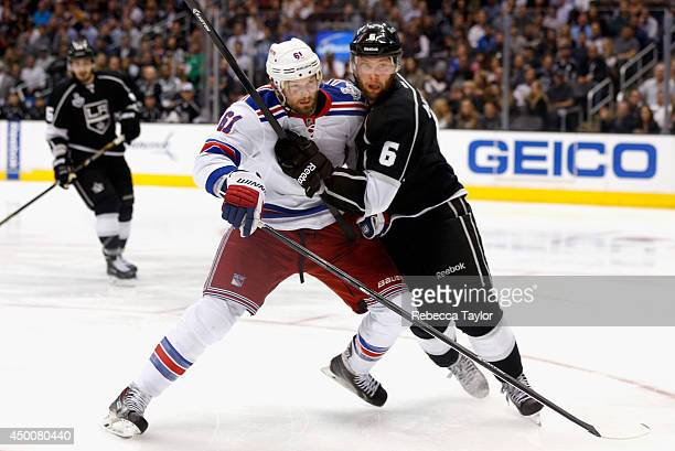 Jake Muzzin of the Los Angeles Kings battles with Rick Nash of the New York Rangers during the third period of Game One of the 2014 Stanley Cup Final...