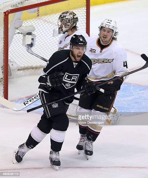 Jake Muzzin of the Los Angeles Kings celebrates after scoring a goal against goaltender John Gibson of the Anaheim Ducks as defenseman Sami Vatanen...