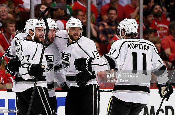 Jake Muzzin of the Los Angeles Kings celebrates his goal with teammates in the third period against the Chicago Blackhawks in Game Two of the Western...