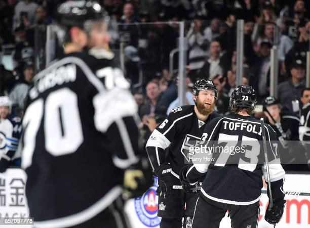 Jake Muzzin of the Los Angeles Kings celebrates his goal with Tyler Toffoli to tie the Winnipeg Jets 22 during the second period at Staples Center on...