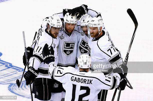 Jake Muzzin of the Los Angeles Kings celebrates with his linemates after scoring on Henrik Lundqvist of the New York Rangers during the second period...