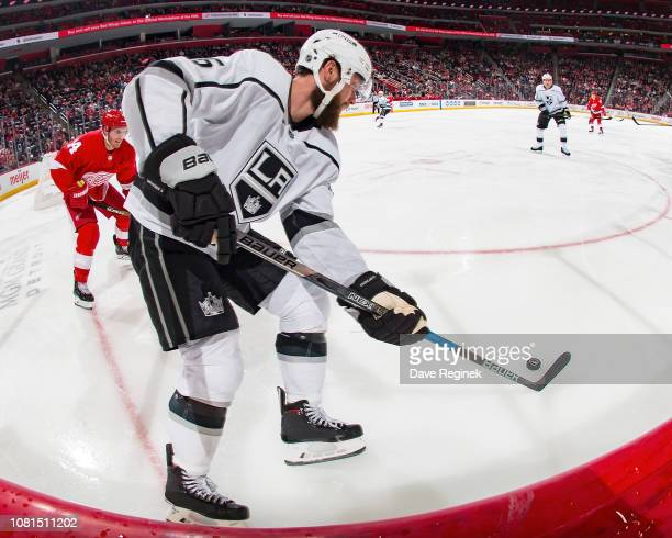 Jake Muzzin of the Los Angeles Kings controls the puck in the corner in front of Gustav Nyquist of the Detroit Red Wings during an NHL game at Little...