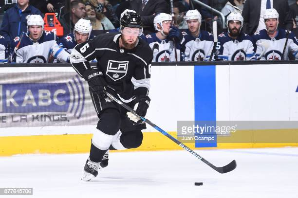 Jake Muzzin of the Los Angeles Kings handles the puck during a game against the Winnipeg Jets at STAPLES Center on November 22 2017 in Los Angeles...