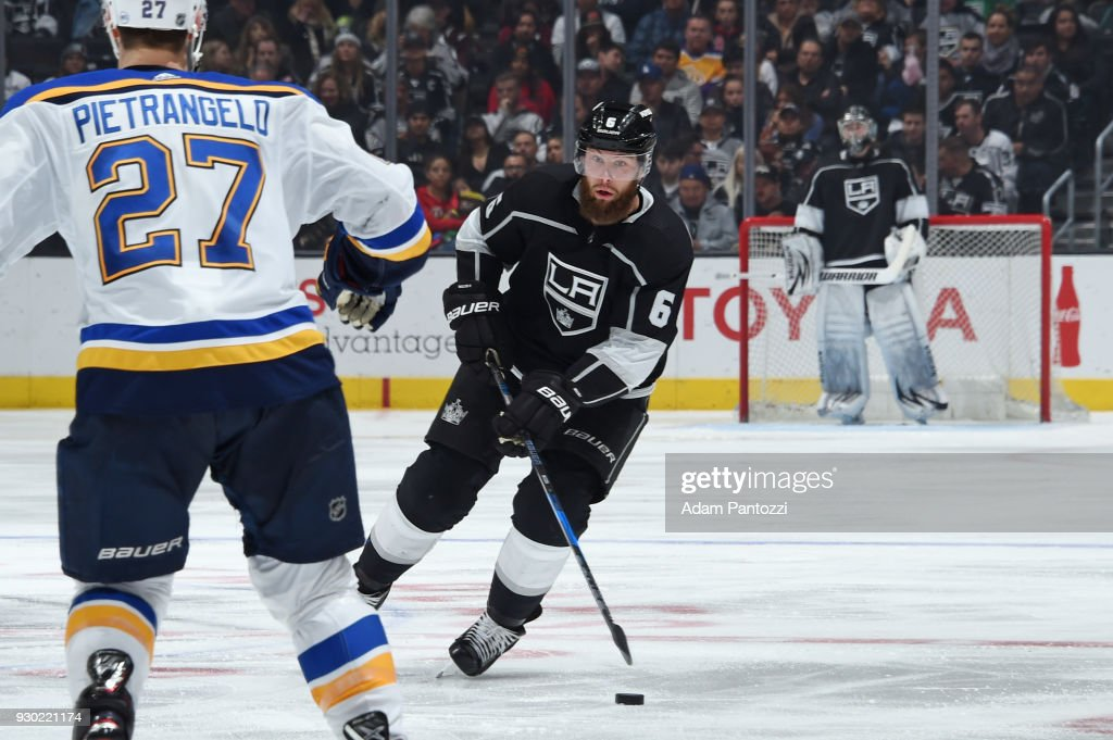Jake Muzzin #6 of the Los Angeles Kings handles the puck during a game against the St. Louis Blues at STAPLES Center on March 10, 2018 in Los Angeles, California.