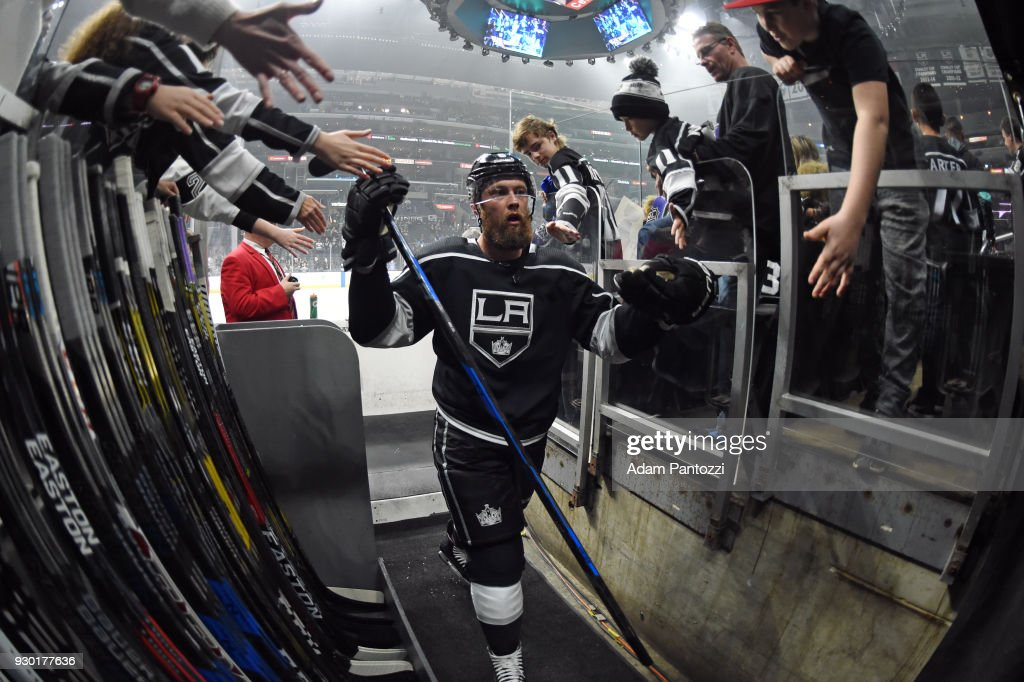 Jake Muzzin #6 of the Los Angeles Kings high-fives fans before a game against the St. Louis Blues at STAPLES Center on March 10, 2018 in Los Angeles, California.