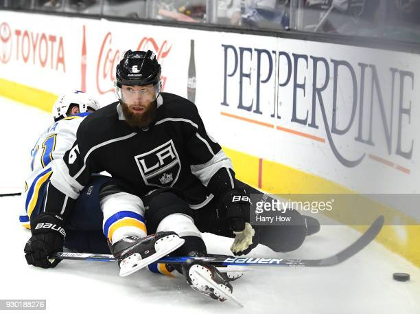 Jake Muzzin of the Los Angeles Kings looks for the puck as he falls to the ice with Vladimir Sobotka of the St Louis Blues during the first period at...