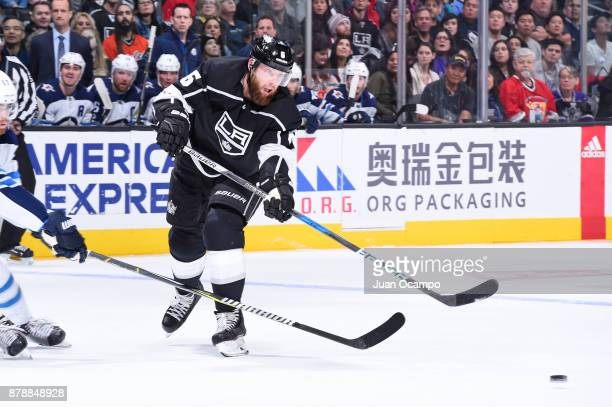 Jake Muzzin of the Los Angeles Kings passes the puck during a game against the Winnipeg Jets at STAPLES Center on November 22 2017 in Los Angeles...
