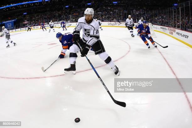 Jake Muzzin of the Los Angeles Kings plays the puck in his own end against the New York Islanders during the first period at Barclays Center on...