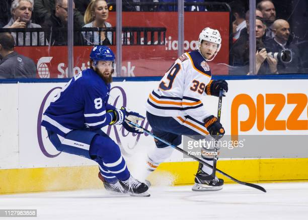 Jake Muzzin of the Toronto Maple Leafs skates against Alex Chiasson of the Edmonton Oilers during the first period at the Scotiabank Arena on...