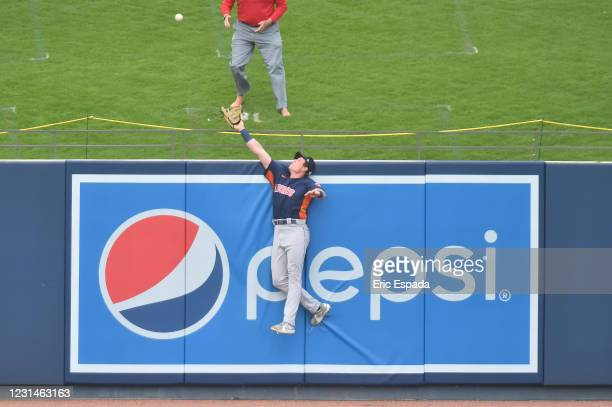 Jake Myers of the Houston Astros jumps for the ball during the third inning of the Spring Training game against the Washington Nationals at FITTEAM...