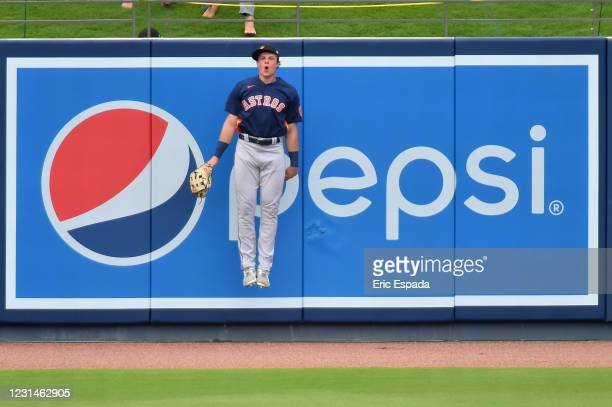 Jake Myers of the Houston Astros reacts after not catching a home run hit by Ryan Zimmerman of the Washington Nationals during the third inning of...
