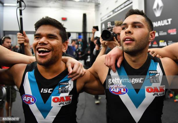 Jake Neade and Jarman Impey of the Power sing the club song after defeating the Magpies during the round 21 AFL match between Port Adelaide Power and...